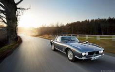 Iso Grifo | More here: http://mylusciouslife.com/stylish-home-luxury-garage-design/