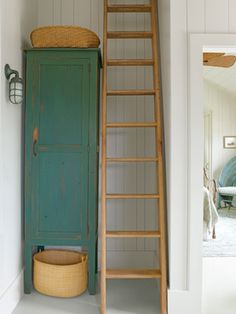 Make the most of a hall corner with a tall and narrow linen cabinet. #storage