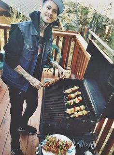 He's grilling. He's Mike Fuentes and he's grilling. Everything about this is perfect but he's not in my backyard grilling...disappointment :c