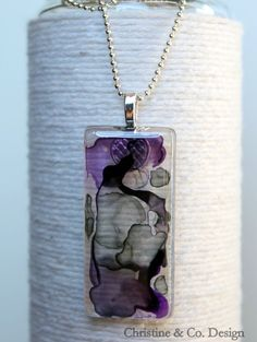 Purple and Gray Alcohol Inked Glass Pendant/ Handbag Charm. $26.00, via Etsy. This is not fused glass, but glass with paint and alcohol design covered with resin.