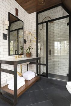 You can combine different materials to get the perfect room decoration on the bathroom. To this project, Jonathan Adler combined wood, tiles, and concrete to create a modern space. ➤To see more Luxury Bathroom ideas visit us at www.luxurybathrooms.eu #luxurybathrooms #homedecorideas #bathroomideas @BathroomsLuxury
