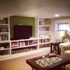 Basement. Rec room. Tv room. Built in shelves.