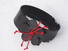 Rubber bracelet recycled rubber from tractor inner tube with red elastic cord via Frey Willemoes-Wissing