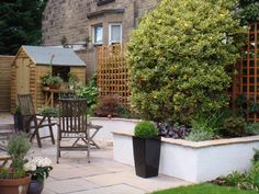 White rendered walls and sandstone paving and coping.