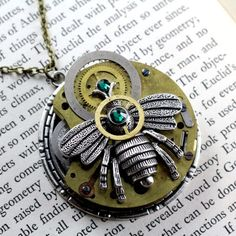 BEE KEEPING TIME CABPOWA115  $30.00  Antique pocket watch with teal Swarovski crystals necklace.