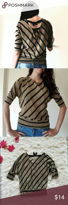 BCX gold top Simple, nice, shiny top. Gold and black. 46% Rayon, 30% Polyester, 12% Nylon, 12% Metallic. Good condition, worn only few times. Size M. BCX Tops Blouses