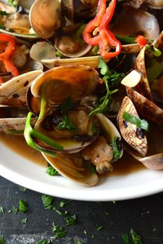 Chinese Stir-fried fresh clams in black bean sauce with garlic, ginger, scallion and cilantro