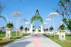 """The Mirage Wedding Chapel by The Grand Mirage   Bali Walk along the special white paved Wedding way to the """"Mirage Chapel by the sea"""" with the gentle lush trees breeze through your hair and the sound of the Ocean. The Mirage Chapel by the sea is the most open air dreamy and magical place for your wedding."""