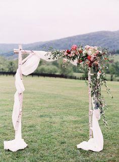 Photography : Michael And Carina Photography | Wedding Dress : Claire Pettibone  | Grooms Attire : Banana Republic  | Venue : King Family Vineyards | Floral Design : Petal Flower Co Read More on SMP: http://www.stylemepretty.com/virginia-weddings/crozet-virginia/2016/08/12/crimson-charlottesville-wedding/