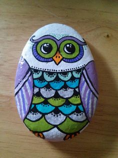 This little owl is hand painted on a river rock from the Sacramento river. She is 3 1/2 tall and about 2 1/2 wide