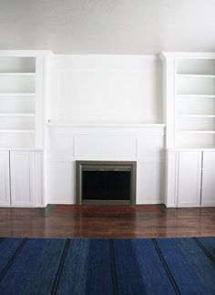 IKEA HACK BUILT-INS: Use inexspensive Ikea cabinet and billy bookcase to make custom cabinets around fireplace.