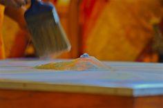 Gathering grains of mandala sand; closing Buddhist service; Oak Bluffs, Martha's Vineyard, Massachusetts, USA.  July 2008.
