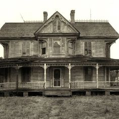 If these porches could talk; the history of this old house is one I would like to read. Is that someone looking out of the second floor window?