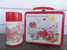 1980s Strawberry Shortcake lunchbox and thermos.  I had this one!