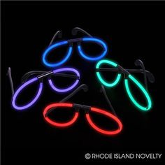 ASSORTED GLOW GLASSES. These Assorted Glow Glasses come with a variety of glowing colorful rims. Simply snap the glass capsule to make the chemicals mix together and create light. This item is perfect for night time parties. Sold by the dozen. #TrickofTreat #Halloween #Lightups #GlowintheDark #CandyFree