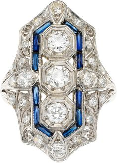 Diamond, Synthetic Sapphire, Platinum Ring.  The ring features European and single-cut diamonds weighing a total of approximately 1.35 carats, enhanced by French-cut synthetic sapphires, set in platinum. Art Deco or Art Deco style.