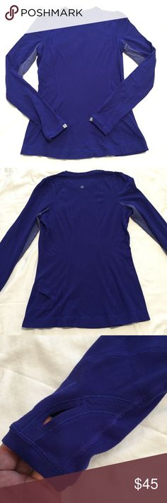 Lululemon Run Back On Track Long Sleeve In good preworn condition. Color is Pigment Blue. Cover photo from luluaddict.com. Has thumbholes and small back pocket. Small pull shown in last pic. lululemon athletica Tops Tees - Long Sleeve