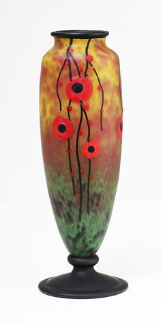 Rare Art Deco poppy vase by Schneider. It has padded and applied wheel-carved poppies, buds and branches, applied rim and foot, and vivid, breathtaking colour. 12 1/4""