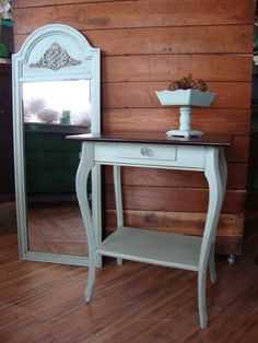 This table has a stained top and the base was painted in Maison Blanche creme de menthe . As was the mirror and accented in a brown glaze.