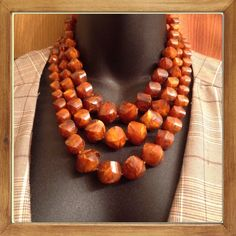 Vintage Triple Row Cinnamon Brown Necklace Wear this statement necklace to complete your look whether you're wearing a low-cut vest (as styled) or with your favorite neutral colored blazer.  However you style it, make a statement! Jewelry Necklaces