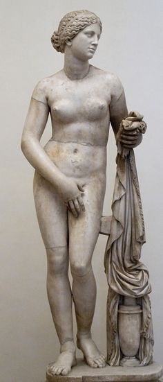 Aphrodite of Cnidus (model: Phryne), a Roman copy of the Greek original marble sculpture of 4th century BC by Praxiteles, restored by Ippolito Buzzi, at National Museum of Rome, Palazzo Altemps, Italy