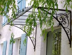 Pergola Attached To House Roof Info: 1662957808 Awning Over Door, Door Overhang, Window Awnings, Pergola Patio, Pergola Plans, Pergola Kits, Eisen Pergola, Grill Gate Design, Wrought Iron Decor