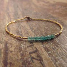 Gold and emerald bracelet