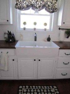 Apron sink, white, butcher block....maybe not white but do love the apron sinks and butcher block counters