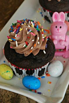 from my easter cupcake photo shoot. food porn ♥ deep chocolate cupcakes with light cocoa buttercream and salted peanut butter filling.