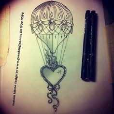 beaded heart and a hot air balloon tattoo