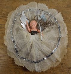 vintage Christmas angel fairy. We had this sort of fairy on our tree, it was my mum's originally, and I can remember it having extra glitter glued to the skirt when it got shabby.
