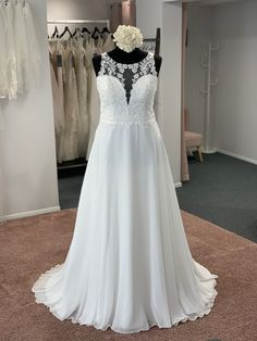 A stunning a line style with an illusion lace neckline, plunge lace bodice, scalloped lace detail at the waist and finished with an illusion lace back. Zip back and buttons. Discount Designer Wedding Dresses, Scalloped Lace, Lace Bodice, Lace Back, Dream Wedding Dresses, Bridal Boutique, Lace Detail, Illusion, Townhouse