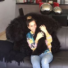 A woman and her Black Russian Terrier. Pure happiness.