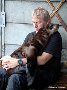 François Hugo cuddling a seal