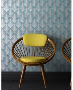 Metalic wallpaper and equally interesting vintage chair.  $75 per roll at grahambrown.com