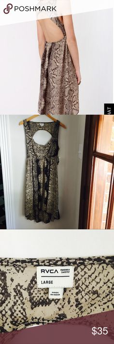 """RVCA snake print open back hi low dress NWT We hope you're expecting a shower of compliments on your RVCA Drench Brown Snake Print Dress, because you're about to get drenched in them! This lightweight woven sundress has a sleeveless bodice with a scoop neckline and a sexy back cutout that dips down past the waist. An elasticized empire waistline flows into a concave hemline with a subtle high-low hem. Front of bodice is lined. Model is wearing a size x-small. Skirt measures 4"""" longer at…"""