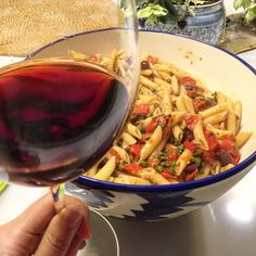 Humongous glass of Super Tuscan and humongous bowl of pasta puttanesca (recipe from Le Sirenuse)!