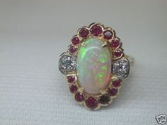 ANTIQUE RETRO OPAL RUBY DIAMOND ENGAGEMENT RING CIRCA ~ 1940'S BLACK OPAL ~ APPROXIMATELY 5.5 CARAT RUBY ~ .80CT T.W. 2 ROUND BRILLIANT CUT DIAMONDS ~ .38CT T.W. COLOR ~ E - F CLARITY ~ VS 2 METAL ~ 14KY & WHITE SOLID GOLD WEIGHT ~ 8.3 GRAMS FINGER SIZE ~ 5.25 (SIZABLE)  U.S.A & CANADA