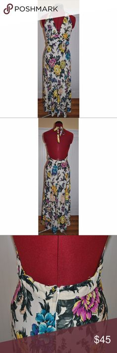 "Vintage Floral Halter Maxi Dress Beautiful vintage maxi dress featuring a halter design in a spring floral print. Supportive halter and non-see through fabric lets you go braless or wear a halter bra for more support. Add a pair of cork wedges and a light tan cross body bag for a cute look. Zipper with hook & eye closure, eye is missing. Theres no size tag but it fits like a Medium. 53"" Long 16"" Across bust 29"" all around waist Vintage Dresses Maxi"