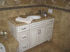 Custom vanity with decorative edge granite built in next to Whirlpool and tile walls.