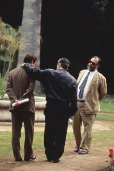 Andy Garcia, Al Pacino, and Francis Ford Coppola on the set of The Godfather Part III.