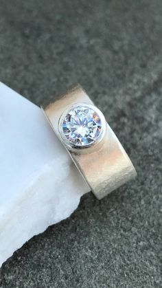 Sterling Silver Etched Wide Band with CZ Solitaire by CopperfoxGemsJewelry on Etsy https://www.etsy.com/listing/543444716/sterling-silver-etched-wide-band-with-cz