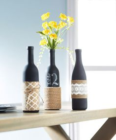 Reuse any of your old wine bottles with these fantastic wine bottle crafts! It's time to put your wine bottles to good use! Try these wine bottle ideas today. Wrapped Wine Bottles, Wine Bottle Vases, Empty Wine Bottles, Wine Bottle Crafts, Bottle Art, Bottle Centerpieces, Paint Wine Bottles, Decorating Wine Bottles, Wedding Centerpieces