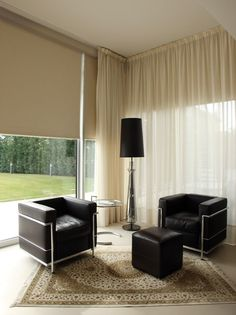 Contemporary room with motorized shades and ceiling mounted drapery.