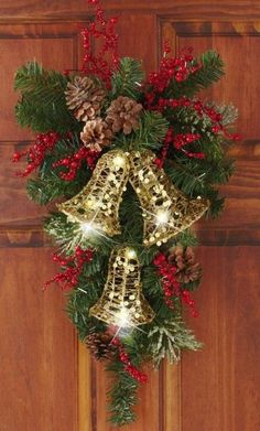 Holiday Bells Evergreen Swag Door Decor - Vertical evergreen floral swag features white lights that dazzle Link Christmas Door Decorations, Christmas Arrangements, Christmas Swags, Christmas Bells, Holiday Wreaths, Christmas Holidays, Christmas Ornaments, Burlap Christmas, Christmas Projects