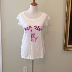 Gap Statue of Liberty shirt Maternity shirt but it wears like a regular loose fitting shirt. Size is x small but it fits like a medium. GAP Tops Tees - Short Sleeve