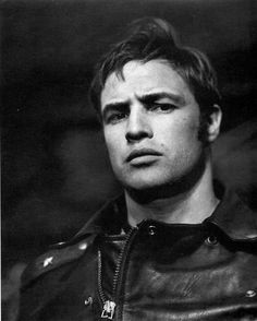 Marlon Brando, 1953, on the set of The Wild One | seriously hot | leather, studs and zips | frown | look | scowl | black & white photography | onset | 1950's | motorcycle diaries | portrait