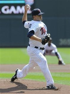 Minnesota Twins pitcher Brian Duensing throws against the Seattle Mariners during the first inning of a baseball game, Thursday, Aug. 30, 2012, in Minneapolis.