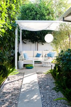I love the soft & comfy look of this patio.