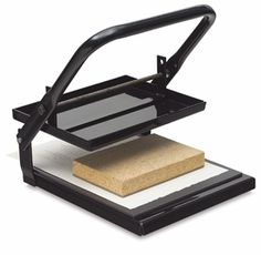 Speedball Press. I have one of these. It helps a lot with large hand carved stamps.
